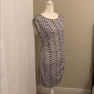 Lavender and white cap sleeve dress.